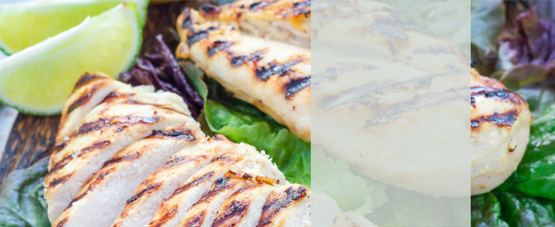 Closeup of chicken breasts with grill marks.