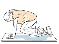 Pregnant woman on all fours doing leg lift exercise.