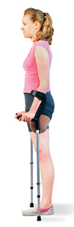 Woman with amputated leg, standing between crutches.