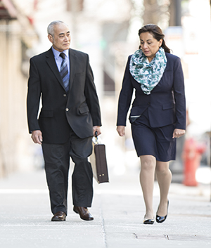 Business man and woman walking together.
