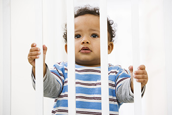 Child looking through baby gate