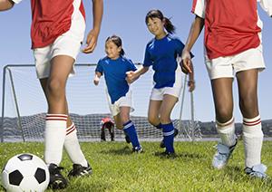 Children playing soccer.