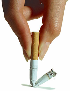 Close up view of a woman's hand putting out a cigarette.