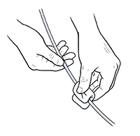 Closeup of hands cleaning catheter.