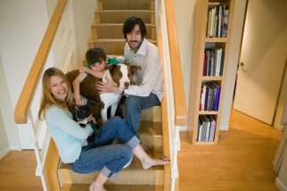 Family on stairs with pets