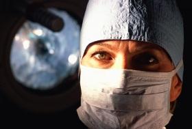 Female surgeon wearing a mask