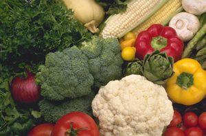 Fresh vegetables, including broccoli, cauliflower, squash, and tomatoes.