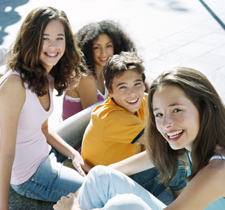 Group of four teens smiling