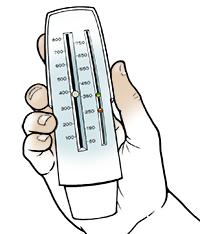 Hand holding peak flow meter.