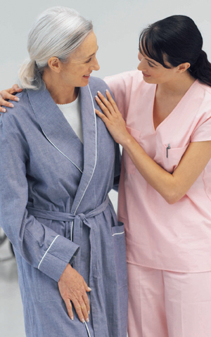Health care provider walking with senior patient.