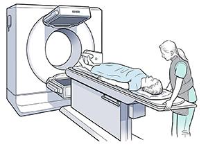 Healthcare provider preparing woman for scan.