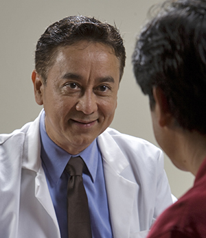 Healthcare provider speaking to a man