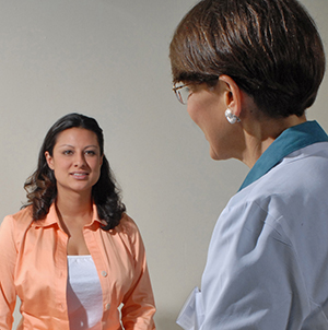 Healthcare provider talking to a female patient