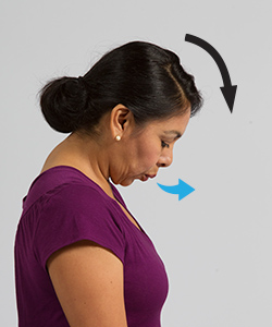 Woman breathing out while doing head tilt exercise.