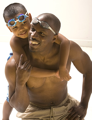 Man and boy in swimming trunks.