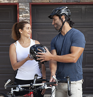 Man and woman getting ready for bike ride.