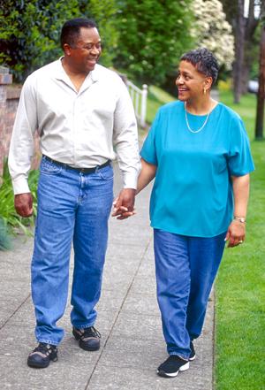 Man and woman outdoors, walking.