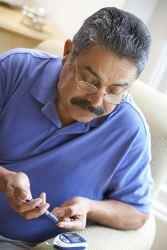Man checking blood glucose