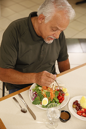 Man eating salad.