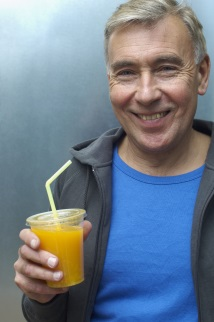 Man holding cup of orange juice