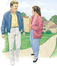 Man in cervical collar outdoors walking with woman.