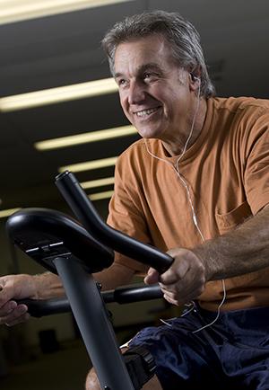 Man riding exercise bike.