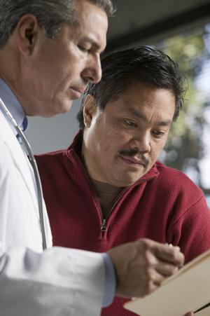 Man talking to doctor.