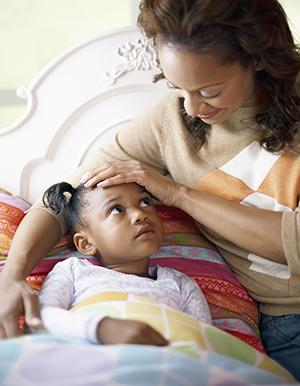 Mother comforting daughter.