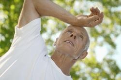 Older man displaying symptoms of fatigue