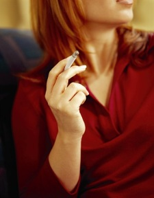 Photo of a woman holding a cigarette