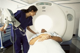 Technician preparing patient for a CT scan