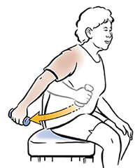 Seated woman doing triceps curls with hand weight.