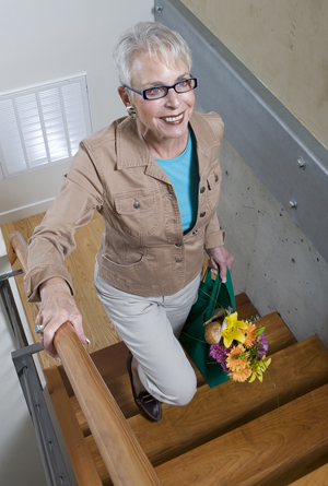 Woman walking up stairs indoors.