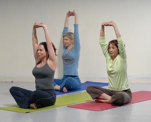 Three women doing yoga.