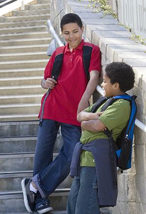 Two kids walking on stairs.