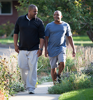 Two men walking outdoors.