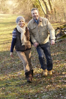 Woman and man walking on trail in cold weather
