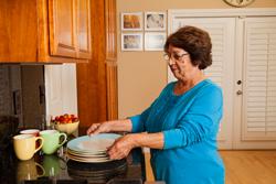 Woman lifting plates.