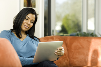 Woman reading an electronic tablet