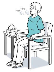 Woman sitting in chair, leaning slightly forward and coughing.