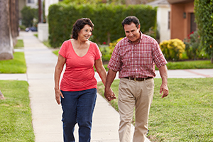 Man and woman outdoors walking.