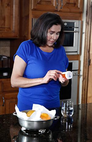Woman taking pills.