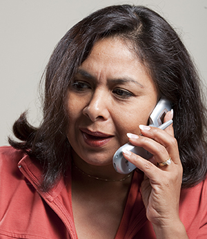 Woman talking on telephone.
