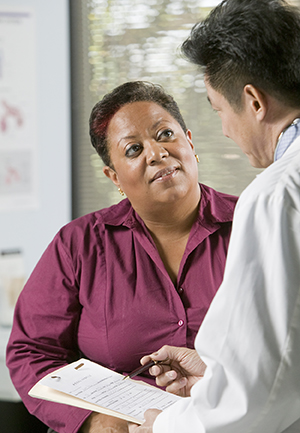 Woman talking to healthcare provider.