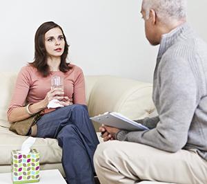 Woman talking to therapist.