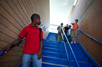 Young teens on the stairs at a school