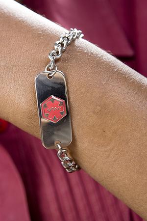 Close up of Medicalert bracelet.