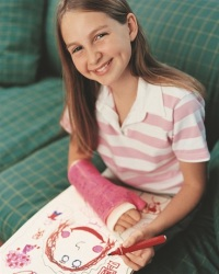 Photo of girl with cast on arm