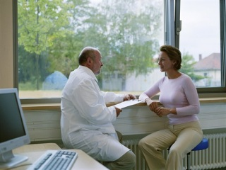 Doctor speaking to a woman in an office setting