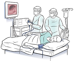Man lying on exam table on side. Health care provider is holding end of colonoscope and looking at pictures on monitor. Another healthcare provider is standing next to table.